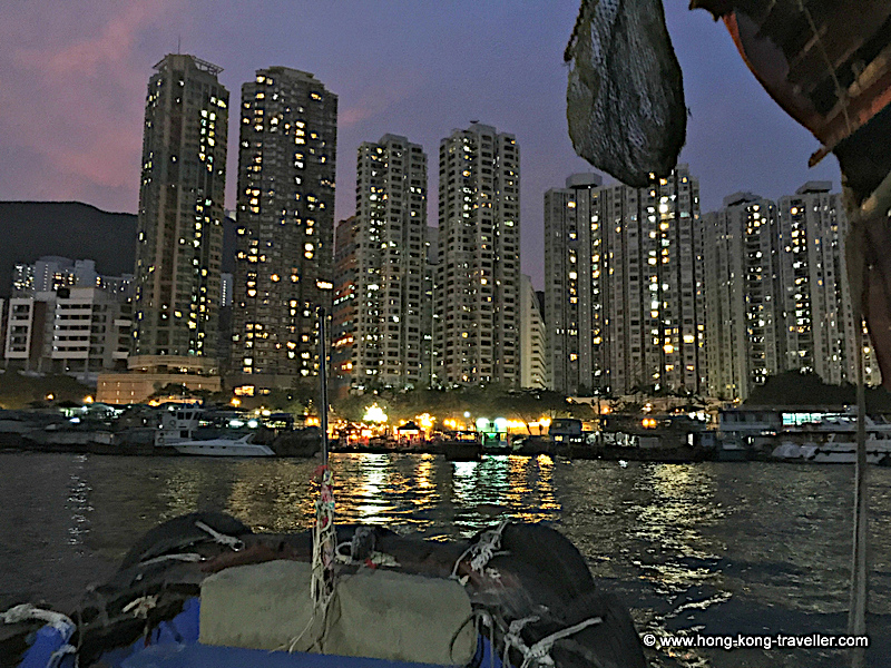 Aberdeen Village Harbour and background highrises at night