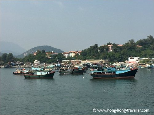 Arriving in Cheung Chau Island, a small crowded harbour with fishing vessels welcomes you