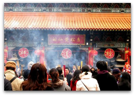 Praying and bringing offerings during the celebrations at Wong Tai Sin Temple