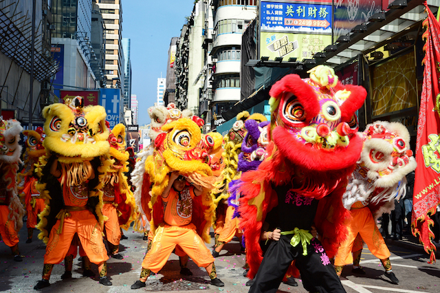Hong Kong Dragon and Lion dance Festival Parade in streets of Kowloon