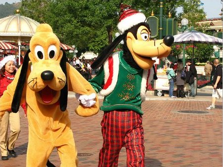Goofy and Pluto along Main Street during Christmas time