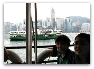 Kids riding the Star Ferry Hong Kong