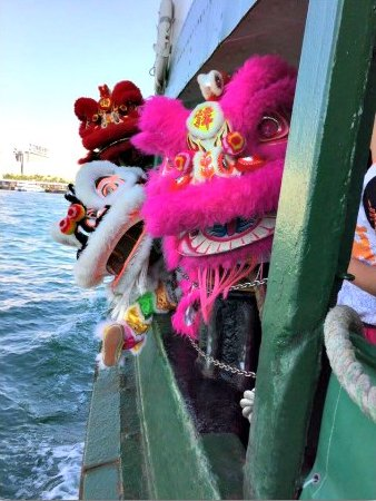 Chinese Lions riding the Star Ferry