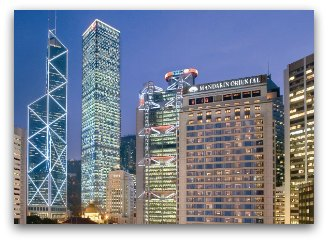 Night view of Mandarin Oriental Hotel in Hong Kong and surrounding cityscape