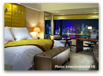 Harbour view room with Convention Center on background at Intercontinental Hotel in Hong Kong at night