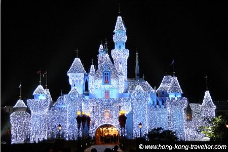 Sleeping Beauty Castle is lit at night during Christmas time, simply stunning