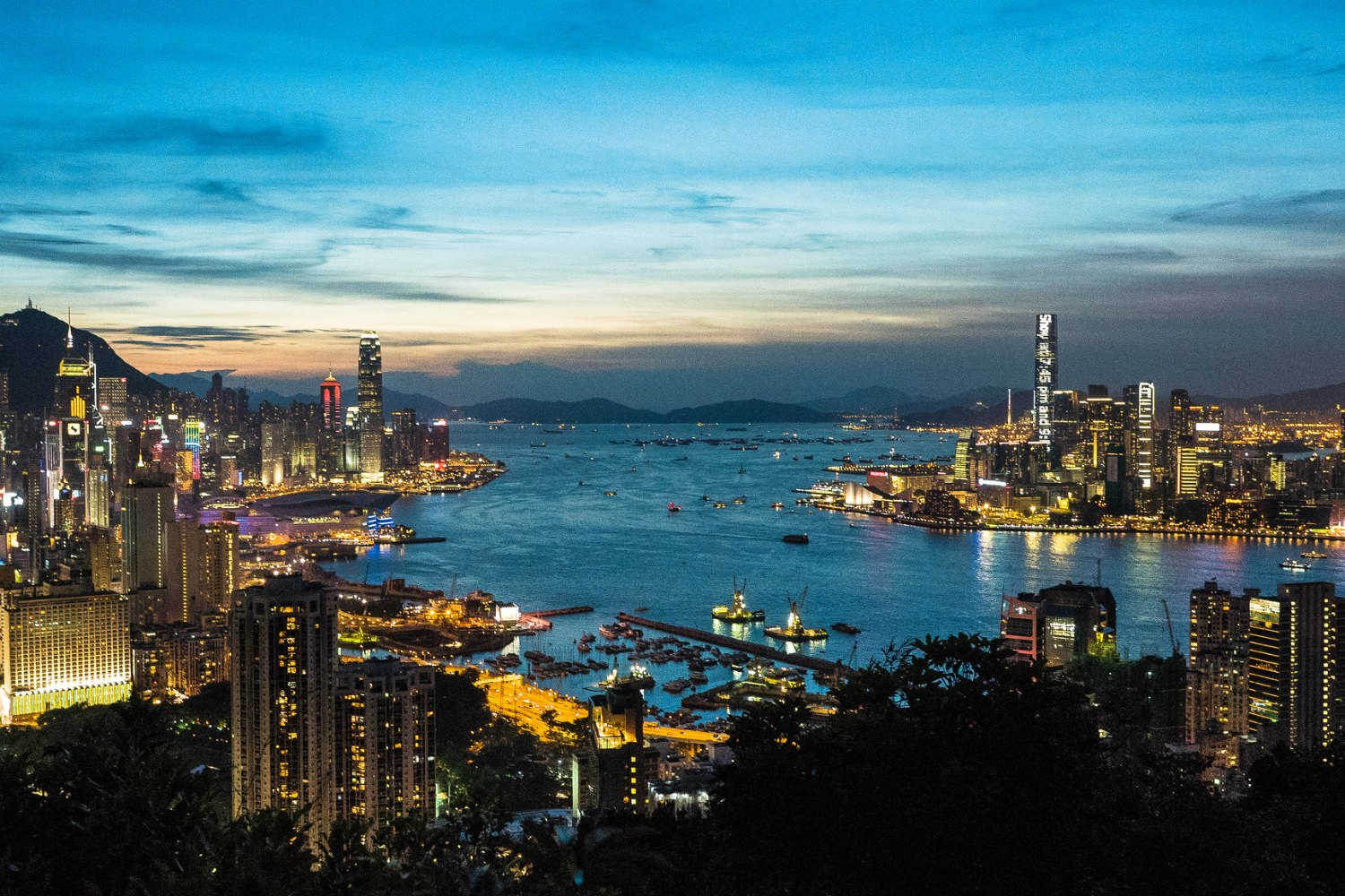 Hong Kong City Lights On Both Sides Of Victoria Harbour