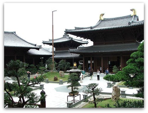Hall of Celestial Kings on one end of the  courtyard dotted with bonsai trees