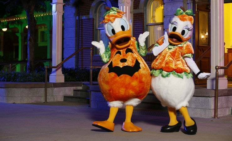 Donald and Daisy in Halloween outfit greet visitors at the entrance