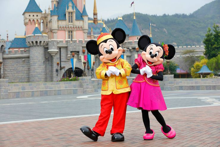 Mickey and Minnie wearing traditional Chinese outfits at Disneyland Hong Kong