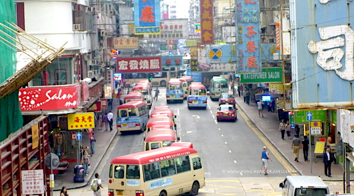 Busy Hong Kong Street with many Transportation Options: buses, mini buses, etc